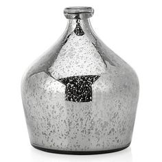 An antiqued silver mercury glass vase makes an elegant accessory. $29.95