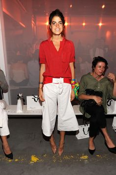 Blogger Leandra Medine attended the 3.1 Phillip Lim fashion show wearing white culottes and a red blouse.