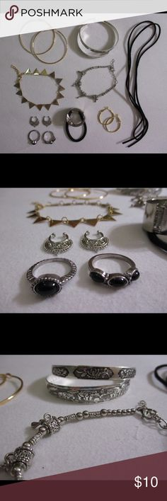 Jewelry Lot Rings Bracelets Earrings Septum Anklet Costume jewelry lot. Not UO, for exposure. -Medium gold hoops -2 Tibetan style silver bracelets (elephant and flower design; the bracelet with the elephant design has a small bent) -Faux suede black string cord choker (long/medium length) -Gold triangle bracelet/anklet -Tibetan style silver bead bracelet -2 silver fake septum nose rings -Silver metal hair band cuff/accessory -2 vintage style rings w/ black stones/gems -Small gold hoops…