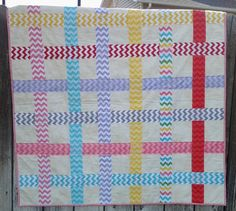 I love chevrons and quilts. What two better things to put together?This quilt is made of 100% high quality cotton fabrics by Riley Blake Fabrics.I give great attention to my quilting, and binding. Beside high quality materials the hand work is what will assure the duration of this quilt....