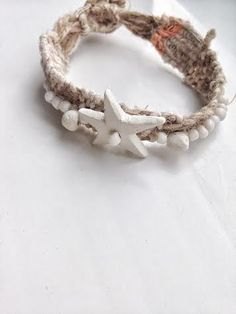 this bracelet is wreath with linen rope and strings, plus handmade clay beads with one star.