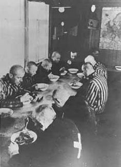 Sachsenhausen prisoners eat a meal in the mess hall.