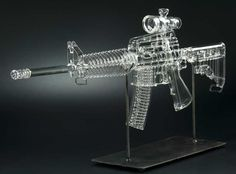 Flame-worked glass replicas of firearms by Robert Mckelson | Mickelson's eye for detail is so amazingly insane that he even incorporates the very ammunition loaded into the magazines themselves. Mickelson originally hails from Belvoir, Virginia, USA and was raised in Honolulu, Hawaii, USA. |