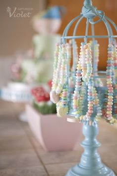 Candy necklaces on a jewelry holder. Adorable for - Candy necklaces on a jewelry holder.  Adorable for a little girl's birthday party! And you can totally paint and decorate the jewelry holders to match the theme...I bet even all the boys would be ok