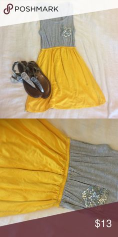 Grey and yellow pocket tee dress This is an adorable flowy dress with a tank top style top and sequin pocket. This is the perfect spring time dress! Rewind Dresses Mini
