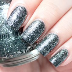 Silver glitter nails.