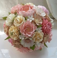 This listing is for a single CUSTOM designed Bridal Bouquet, diameter measurements varying based on final design. The flowers made with smooth, heavy cardstock that is acid free. **Please contact us for our color chart**  All bouquets are made specifically for the purchaser, with color choices, minute details, etc tweaked to the purchasers selection. These blooms will last a lifetime, freezing a moment in time of your special day. Customized packages are available with add ons such as…
