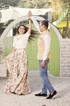Sonam dressed in a white satin shirt and floral skirt designed specially for her pre wed shoot