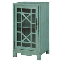 Awash in a sea blue finish, this weathered cabinet showcases 1 glass door with a fretwork overlay.    Product: CabinetCo...