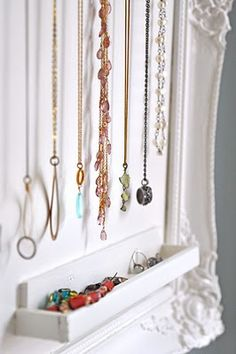 do-it-yourself jewelry storage---cool idea......instead of painting the plywood backing, i would find an awesome wall paper and apply to plywood or mod podge a design onto it. Instead of the eye hooks to hold the jewelry, I would use decorative door knobs (anthropologie.com or hobby lobby carry nice ones).