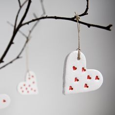 ceramic heart ornaments, three ceramic hanging hearts, whote and red, spring home decor, summer garden, wedding favour by karoArt cearmics. €15,00, via Etsy.