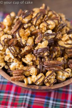 Turtle Caramel Corn with pecans and drizzled with milk chocolate, this popcorn is perfect all year long not just at Christmas! Turtle Caramel Corn with Pecans and Chocolate Does anyone even know why Snack Mix Recipes, Popcorn Recipes, Candy Recipes, Yummy Snacks, Holiday Recipes, Delicious Desserts, Dessert Recipes, Cooking Recipes, Yummy Food