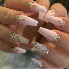 Soft matte pink ballerina nail with​ golden accents.
