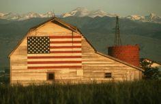 Flag on the side of a big beautiful barn--beautiful!