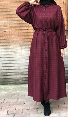 Hijabi wearing a buttoned gown and boots – – Hijab Fashion Modest Fashion Hijab, Modern Hijab Fashion, Islamic Fashion, Hijab Chic, Abaya Fashion, Muslim Fashion, Fashion Dresses, Fashion Black, Fashion Fashion