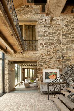 Stone Walls Cathedral Rafters lend Old World Timelessness to