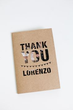 """This die cut typographic Thank You card uses the image behind the die cut type to give the front a """"pattern"""" through the type windows. The image gives it color and also insures that each will be unique."""