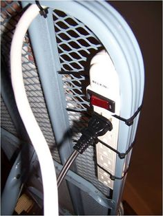 Solve the problem of a too short iron cord. Attach a power cord to your ironing board with zip ties.