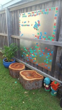 Outdoor Magnetic Board.  Simply screw sheets of steel to your wooden fence, add a few decos and a tonne of Alphabet Magnets and voila! The kids love it.