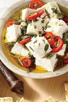 Olive oil and a sprinkling of fresh herbs create an ultra-flavorful marinade for feta cheese. Serve on crackers or spread on crusty bread for an elegant appetizer.#myrecipes #comfortfood #comfortfoodrecipes #casserole #hotdish #casserolerecipes #hotdishrecipes