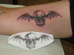 There are hundreds tattoo designs available these days, and bat tattoo seems to be the most durable design ever where … Arm Tattoos For Guys, Future Tattoos, Love Tattoos, Avenged Sevenfold Tattoo, Band Tattoo, First Tattoo, Skin Art, Tattoo Designs, Tattoo Ideas