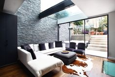 Chelsea terraced house - lower ground floor glass extension with slate feature wall