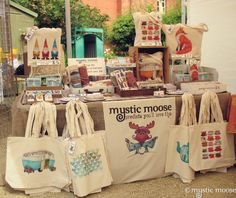 Mystic Moose Craft Stall. There is a lot of product packed into one table, great use of space on and around the table!