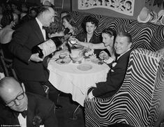 Bringing out the big gun: John Perona (right), owner of the glitzy 20th-century Manhattan nightclub El Morocco, celebrates New Year's Eve with guests in 1951 - he died ten years later