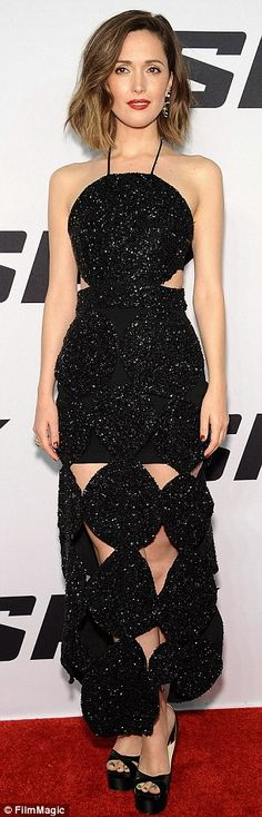 Gorgeous! Australian actress Rose Byrne sizzled in a sparkly black cut-out gown that allowed glances at her legs and slender waistline on Monday at the Spy premiere in New York