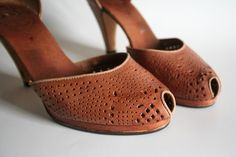 I am all about Vintage 70's peep toe leather pumps.