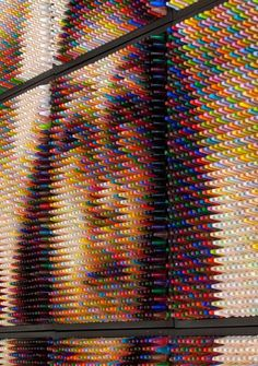 Ohio artist Christian Faur creates photorealistic portraits out of thousands of tightly packed crayon tips.