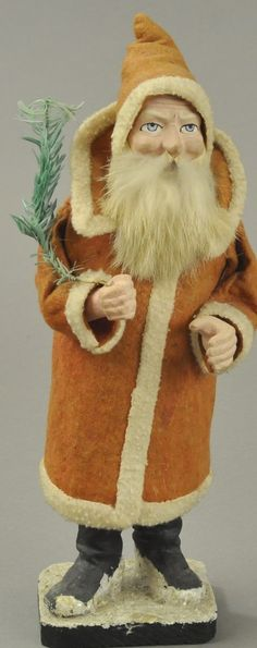 "Composition figure with rabbit fur beard, wearing a long red felt robe, trimmed in white with upturned collar, holding feather tree sprig in hand, separates at waist for candy retrieval. 11"" h. (VG - Exc. Cond.)"