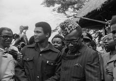 Ali shares time with Zaire president Joseph Mobuto (right) during the build-up to the Rumble in the Jungle