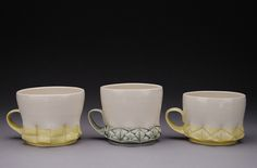 Kyla Toomey mugs: 2012-2013 Kansas State Ceramics Residency Program. Love the detail and handle placement!