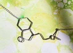 DMT Molecule Necklace - Dimethyltryptamine (DMT) is a naturally occurring neurotransmitter created by the 3rd eye pineal gland and may be released in massive amounts during birth, death, hallucinations and dreams.    DMT is also found in many plants used by South American shamans.