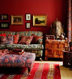The yellow house on the beach: Bohemian chic  Gosh I LOVE this red wall....would love to do something like this to change up my living room.