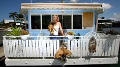 Suzi Duncan moved into her houseboat so she could make money off her Broadbeach Waters mansion on Airbnb. Photo: David Clark