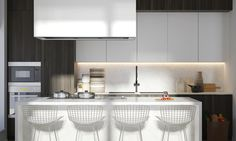 The kitchen is perhaps the only room not defined by dramatic lighting. Instead, pure white surfaces and geometric forms provide a clean and inviting workspace decorated with subtle marble cladding on the island and backsplash.