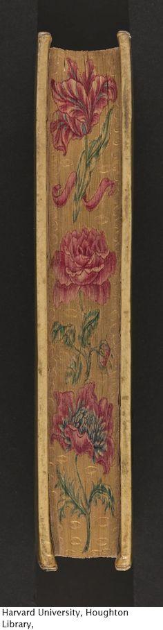"""book with its edges decorated in embossed gold (known as """"gauffering"""") and painted in a floral design.  Ribadeneyra, Pedro de, 1526-1611.Vita del P. Ignatio Loiola, fondatore della religione della Compagnia di Giesù, 1586."""