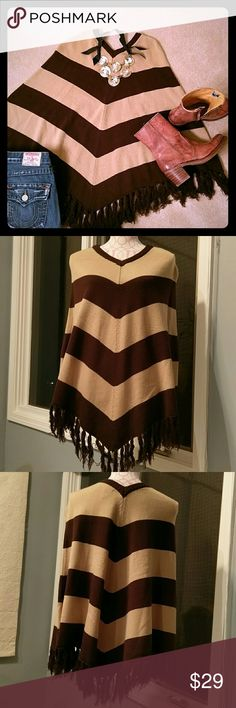 Poncho Great condition. Perfect for the chilly nights. Adorable fringe at the bottom. One size fits all! Derek Heart Sweaters Shrugs & Ponchos