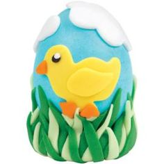 It's a Chick Scene Easter Egg. Create a springtime scene with a hard-cooked Easter egg decorated in bright colors and a cute chick!