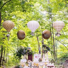 These unique paper lanterns shaped like hot air balloons will give your aerial displays an added layer of personality. Made from white paper with gold print, simply suspend them at your reception and