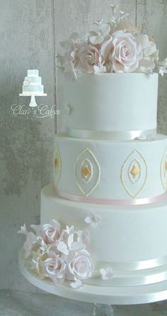 Beautiful Ivory, soft pink and gold 3 tier wedding cake. #weddingcake Clare's cakes Leicester