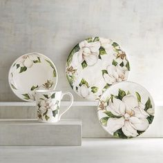 White magnolias represent purity and perfection, making them, well, the perfect floral accent. Crafted of glazed ironstone, each piece of our durable Magnolia Dinnerware adds a light, fresh touch to your table. And they're dishwasher-safe! Perfect.