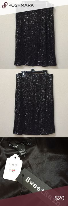 """NWT black sequin skirt Add a little sparkle to your day with this NWT black sequin skirt. Size large. Elastic waist. Laid flat it is approximately 14.5"""" across the waist and 21"""" long. Skirts"""