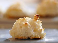 "coconut macaroons from the Glitter Guide; poster bakes for Passover and are an ideal Pesach food (do not contain leavened grain products and made with egg whites); gluten free; orginated in an Italian monastery in 1792; ""macaroon"" comes from the Italian word for paste (maccarone) which refers to almond paste; macaroni means 'flour paste'"