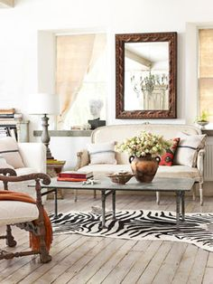 The zebra rug gives a touch of the unexpected to this French-inspired living room. #decorating