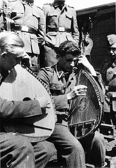 TRAITORS OF THE RUSSIAN LAND.Ukrainians, defectors fighting for Germany from the Soviet Union and Ukraine. They are bored by his country and played in Ukrainian musical instrument BANDURA.