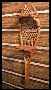 Shelf made out of a vintage snowshoe - cool!