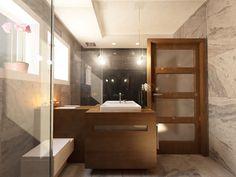 Aranżacja wnętrza łazienki gościnnej w domu w Łomiankach - Tissu. Dzięki zastosowaniu kontrastowych barw pomieszczenie zyskało wyrazisty charakter. Czarne płytki na wysoki połysk i białe kamienne nadają elegancki ton. Drewno sprawia, że wnętrze nie jest zimne i surowe. http://www.tissu.com.pl/zdjecia/178